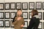 Игорь Степанов на фоне своих работ